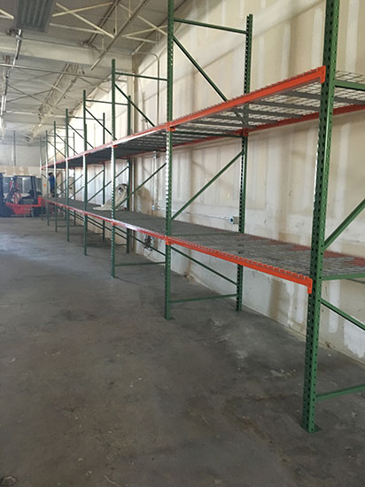 Pallet racking heavy shelving orange and green